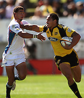 Hurricanes winger Hosea Gear hands off his Cheetahs opposite Bjorn Basson..Super 14 rugby union match, Hurricanes v Cheetahs at Yarrows Stadium, New Plymouth, New Zealand. Saturday 7 March 2009. Photo: Dave Lintott / lintottphoto.co.nz