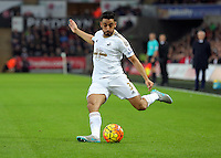 Neil Taylor of Swansea crosses the ball during the Barclays Premier League match between Swansea City and Leicester City at the Liberty Stadium, Swansea on December 05 2015