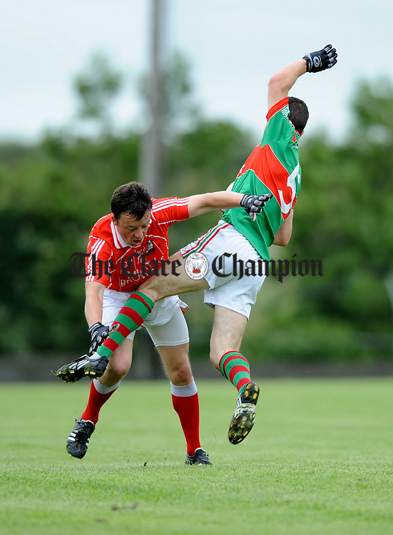 Michael Coughlan of Shannon Gaels and Shane Hickey of Kilmurry Ibrickane in action during their Cusack Cup Semi Final at Kilmihil. Photograph by John Kelly.