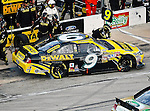 Marcos Ambrose, driver of the (9) Stanley Ford, makes a pit stop during the Samsung Mobile 500 Sprint Cup race at Texas Motor Speedway in Fort Worth,Texas.