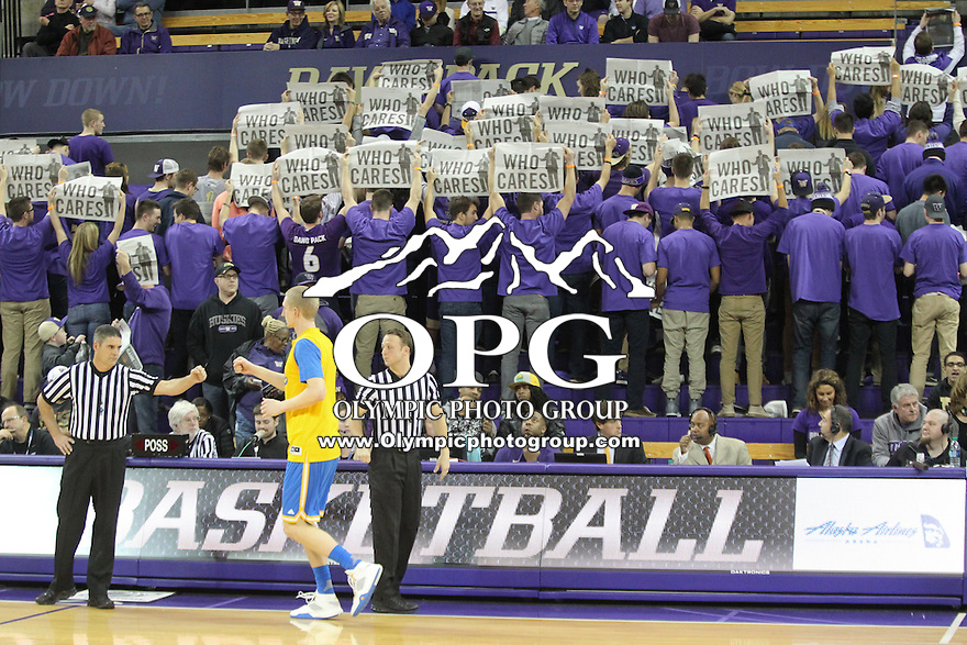 JAN 1, 2016:  Washington fans turned their backs to the players of UCLA as they were announced before the game.  Washington defeated #25 ranked UCLA 96-93 in double overtime at Alaska Airlines Arena in Seattle, WA.