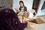 Rheam Abou-Ezze, a nutritionist for International Orthodox Christian Charities, explains the contents of a baby kit she is delivering to a Syrian refugee woman who just gave birth to a baby boy in the village of Qaraolin in Lebanon's Bekaa Valley. The refugee woman asked not to be identified. The baby kit was provided by the IOCC, one of several members of the ACT Alliance which are assisting Syrian refugees in Lebanon in a variety of ways..