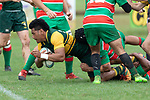 Sione Fifita gets taken to groundAlamoti Funaki. Counties Manukau Premier Club rugby game between Pukekohe and Waiuku, played at Colin Lawrie Fields, Pukekohe on Saturday April 14th, 2018. Pukekohe won the game 35 - 19 after leading 9 - 7 at halftime.<br /> Pukekohe Mitre 10 Mega -Joshua Baverstock, Sione Fifita 3 tries, Cody White 3 conversions, Cody White 3 penalties.<br /> Waiuku Brian James Contracting - Lemeki Tulele, Nathan Millar, Tevta Halafihi tries,  Christian Walker 2 conversions.<br /> Photo by Richard Spranger