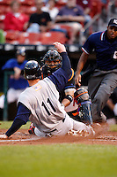 June 29, 2009:  Catcher Robinson Cancel (2) of the Buffalo Bisons blocks the plate to tag out Keith Ginter (11) during a game at Coca-Cola Field in Buffalo, NY.  The Bisons are the International League Triple-A affiliate of the New York Mets.  Photo by:  Mike Janes/Four Seam Images