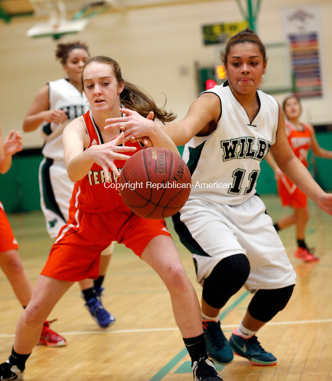 Waterbury, CT- 28 December 2015-122815CM08- Terryville's Brianna Hanlon, left, and Wilby's Jerica Fabian  try to secure the ball during their non-league basketball matchup in Waterbury on Monday.   Christopher Massa Republican-American