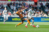SWANSEA, WALES - APRIL 04: Bafetimbi Gomis of Swansea City  in action during the Premier League match between Swansea City and Hull City at Liberty Stadium on April 04, 2015 in Swansea, Wales.  (photo by Athena Pictures)