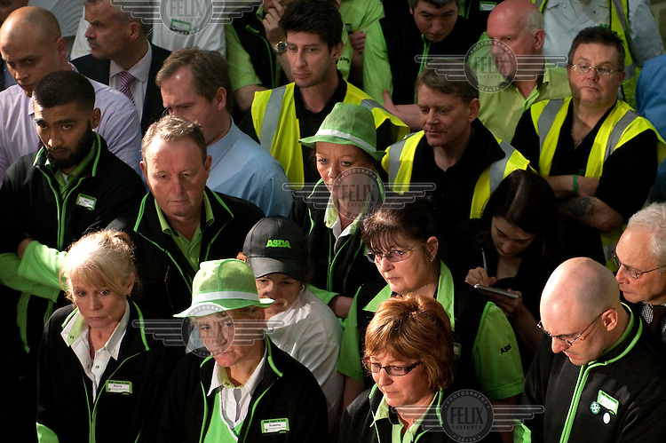 Workers at an Asda supermarket in Weymouth listen to a speech by Prime Minister and Labour Party leader Gordon Brown.