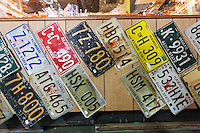 Old Hawai'i license plates for sale inside Glass From the Past Antique Store in Honomu, Big Island.
