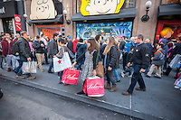 Hordes of shoppers outside of Macy's Herald Square in New York on the day after Thanksgiving, Black Friday, November 27, 2015. The National Retail Federation estimates that 135.8 million American will shop in person and online during the four day Thanksgiving weekend.  (© Richard B. Levine)
