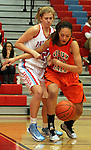 SIOUX FALLS, SD - JANUARY 22:  Emilee Pierson #42 from Lincoln battles for a loose ball with Sydney Koel #52 from Washington in the first half of their game Tuesday night at Lincoln. (Photo by Dave Eggen/Inertia)