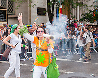 The marijuana advocates in the annual Lesbian, Gay, Bisexual and Transgender Pride Parade on Fifth Avenue in New York on Sunday, June 28, 2015. The parade was particularly boisterous due to the recent Supreme Court decision on same-sex marriage. The parade is the largest gay pride parade in the world.(© Richard B. Levine)