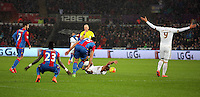 Match referee Mike Dean gives a foul kick to Swansea after Mile Jedinak of Crystal Palace brought down Wayne Routledge of Swansea during the Barclays Premier League match between Swansea City and Crystal Palace at the Liberty Stadium, Swansea on February 06 2016