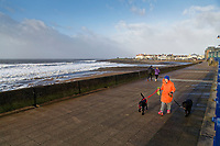 WEATHER PICTURE WALES<br /> Pictured: A woman takes a stroll with her two dogs by the promenade in the seaside town of Porthcawl, south Wales, UK. Wednesday 03 January 2018<br /> Re: Storm Eleanor affects parts of the UK.