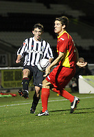 Anton Brady chips over Grant Munro in the St Mirren v Dunfermline Athletic Clydesdale Bank Scottish Premier League U20 match played at St Mirren Park, Paisley on 2.10.12.