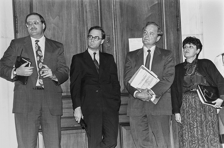 """Michael Gale, Deputy Assistant to Secretary, Craig Helsing, Assistant Secretary for Legislature and Inter-government Affairs, Michael Darby, Administrator of Economic Affairs and Commerce (holds Mosbacher Subpoena in cums ) and Glenda Etchison, Congress Liaison Officer for the Department of Commerce people listening intently to an angry Chairman Rep. Thomas C. Sawyer, D-Ohio, back of Mosbacher """"no show"""", (Photo by Laura Patterson/CQ Roll Call via Getty Images)"""
