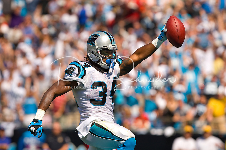 Carolina Panthers running back DeAngelo Williams (34) celebrates a touchdown against the Kansas City Chiefs during a NFL football game at Bank of America Stadium in Charlotte, NC.