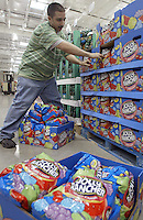 Tomas Babilonia straightens inventory at a Costco Wholesale Warehouse Friday, March 9, 2007 in Columbus, Ohio.