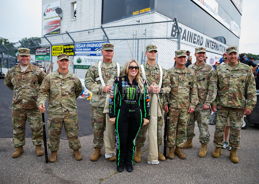 Aug 20, 2017; Brainerd, MN, USA; NHRA top fuel driver Brittany Force with US Army soldiers during the Lucas Oil Nationals at Brainerd International Raceway. Mandatory Credit: Mark J. Rebilas-USA TODAY Sports
