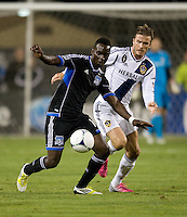 Simon Dawkins of Earthquakes controls the ball away from David Beckham of LA Galaxy during the game at Buck Shaw Stadium in Santa Clara, California on November 7th, 2012.   LA Galaxy defeated San Jose Earthquakes, 3-1.