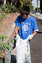 "A member of Millbrae Leos Club on the hunt for trash. Volunteers in the City of Millbrae participated in California Coastal Cleanup Day on 9/19/09. Participants cleaned up inland locations throughout the city as well as at Bayfront Park on the San Francisco Bay shoreline. The inland cleanup efforts were important because, according to the California Coastal Commission, ""past Coastal Cleanup Day data tell us that most (between 60-80 percent) of the debris on our beaches and shorelines comes from inland sources, traveling through storm drains or creeks out to the beaches and ocean. Rain or even something as simple as hosing down a sidewalk can wash cigarette butts, bits of styrofoam, pesticides, and oil into the storm drains and out to the ocean."" The California Coastal Cleanup Day (http://www.coastal.ca.gov/publiced/ccd/ccd.html) is sponsored by the California Coastal Commission and is a part of the International Coastal Cleanup organized by The Ocean Conservancy."