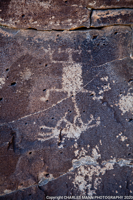 Hundreds of ancient petroglyphs can be seen near the Santa Fe River in Santa Fe County, New Mexico.