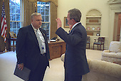United States President George W. Bush talks with Larry Lindsey, Director of the National Economic Council, in the Oval Office of the White House in Washington, DC,  October 31, 2001. <br /> Mandatory Credit: Paul Morse / White House via CNP