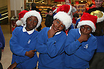Matilda, Imran and Tega at the Christmas Carol Singing with Mell National School...Photo NEWSFILE/Jenny Matthews.(Photo credit should read Jenny Matthews/NEWSFILE)....This Picture has been sent you under the condtions enclosed by:.Newsfile Ltd..The Studio,.Millmount Abbey,.Drogheda,.Co Meath..Ireland..Tel: +353(0)41-9871240.Fax: +353(0)41-9871260.GSM: +353(0)86-2500958.email: pictures@newsfile.ie.www.newsfile.ie.FTP: 193.120.102.198.