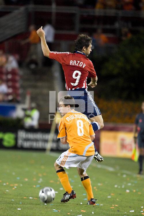 Chivas USA forward Ante Razov (9) jumps  as Houston Dynamo defender Richard Mulrooney (8) dribbles away.  The Houston Dynamo tied CD Chivas USA 0-0 at Robertson Stadium in Houston, TX on May 3, 2008.