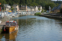 Boats moored along the Rance river in Dinan, Brittany, France.