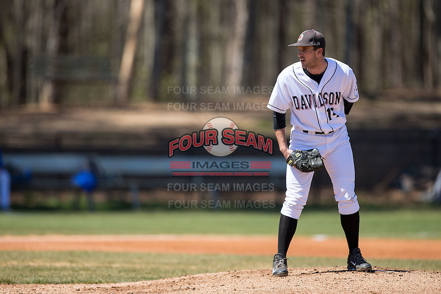 Davidson Wildcats starting pitcher Rob Bain (14) looks to his catcher for the sign against the Saint Louis Billikens at Wilson Field on March 28, 2015 in Davidson, North Carolina. (Brian Westerholt/Four Seam Images)