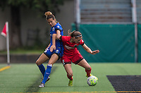 Seattle, Washington - Saturday May 14, 2016:  Seattle Reign FC defender Carson Pickett (16) and Portland Thorns FC defender Katherine Reynolds (2) during the first half of a match at Memorial Stadium on Saturday May 14, 2016 in Seattle, Washington. The match ended in a 1-1 draw