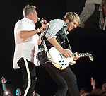 Gary LeVox and Joe Don Rooney of the country music band Rascal Flatts perform at the Susquehanna Bank Center in Camden New Jersey July 9, 2011.Copyright EML/Rockinexposures.com..