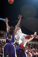 STANFORD, CA - February 12, 2011: Nnemkadi Ogwumike of the Stanford Cardinal women's basketball team flips over Washington's Heard during Stanford's 62-52 win over Washington at Maples Pavilion.
