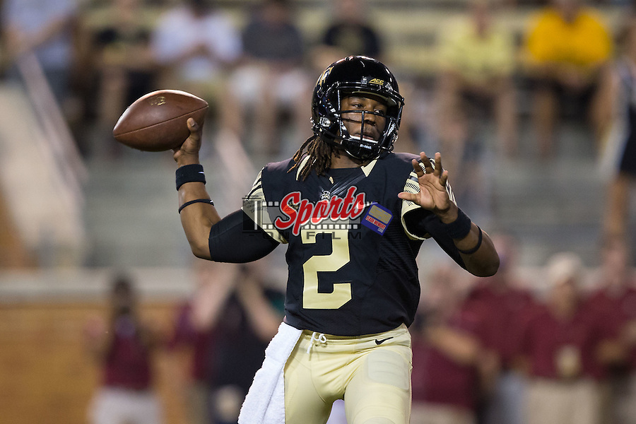 Kendall Hinton (2) of the Wake Forest Demon Deacons passes the football during second half action against the Elon Phoenix at BB&T Field on September 3, 2015 in Winston-Salem, North Carolina.  The Demon Deacons defeated the Elon Phoenix 41-3.   (Brian Westerholt/Sports On Film)