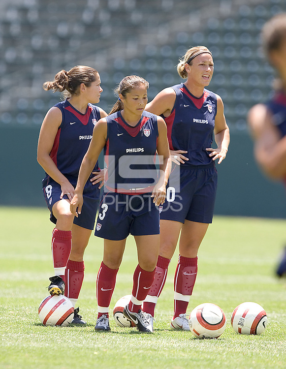 Shannon MacMillan, Lorrie Fair, and Abby Wambach warm up. The USA defeated Iceland, 3-0, at the Home Depot Center in Carson, CA on July 24, 2005.