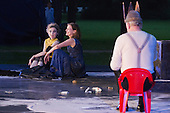 "11 July 2014, Muelheim/Ruhr, Germany. Simone Thoma as Antigone, Petra von der Beek as Ismene and Volker Roos as Creon/Kreon. Roberto Ciulli's ""Theater an der Ruhr"" perform ""Antigone"" as part of their open-air season ""Weisse Naechte"" (White Nights) in Raffelbergpark, Muelheim an der Ruhr, Germany."