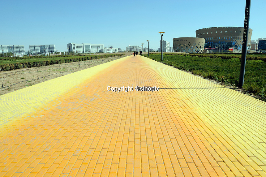 A road through Genghis Khan Square in Kangbashi district of the Chinese city of Ordos, Inner Mongolia. 12-May-2011