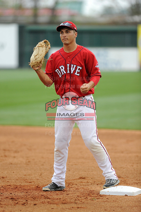 First baseman Nick Longhi (21) of the Greenville Drive during a Media Day first workout of the season on Tuesday, April 7, 2015, at Fluor Field at the West End in Greenville, South Carolina. (Tom Priddy/Four Seam Images)