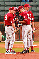 NASHVILLE, TENNESSEE-Feb. 27, 2011:  Mark Marquess, head coach, and Zach Jones, Jordan Pries, and Stephen Piscotty discuss strategy at a mound conference during the game at Vanderbilt.  Stanford defeated Vanderbilt 5-2.