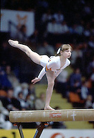 Daniela Silivas of Romania performs balance on balance beam at 1985 European Championships in women's artistic gymnastics at Helsinki, Finland in late April, 1985.  Photo by Tom Theobald.