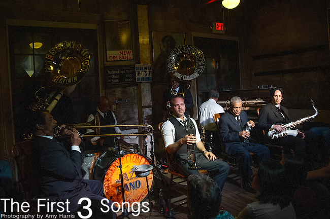 Freddie Lonzo, Joe Lastie Jr., Clint Maedgen, Rickie Monie, Mark Braud, Ronell Johnson, Charlie Gabriel, and Ben Jaffe of the Preservation Hall Jazz Band perform at Preservation Hall in New Orleans, LA.