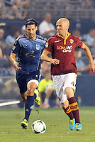 Sporting Park, Kansas City, Kansas, July 31 2013:<br /> Michael Bradley (4) midfield AS Roma pursued by Omar Gonzalez.<br /> MLS All-Stars were defeated 3-1 by AS Roma at Sporting Park, Kansas City, KS in the 2013 AT & T All-Star game.