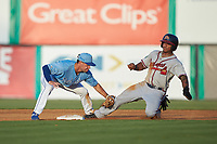 Willie Carter (15) of the Danville Braves is tagged out by Jack Gethings (49) of the Burlington Royals as he attempts to steal second base at Burlington Athletic Stadium on August 9, 2019 in Burlington, North Carolina. The Royals defeated the Braves 6-0. (Brian Westerholt/Four Seam Images)