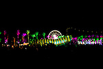 A giant glowing caterpillar art piece makes its way across a field at the Coachella Valley Music and Arts Festival in Indio, California April 10, 2015. (Photo by Kendrick Brinson)