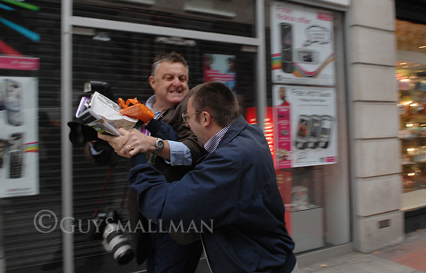 Metronet manager attacks photographer Glenn Copus from the  Evening Standard Newspaper. The incident occured outside the Metronet Headquarters in Holborn duriing a picket by striking RMT members. A few seconds prior to this incident the same Metronet employee assaulted a cameraman.