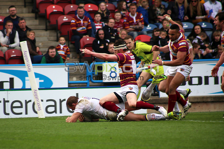Picture by Harry Whitehead/SWpix.com - 30/03/2014 - Rugby League - First Utility Super League - Huddersfield Giants v Warrington Wolves - John Smith's Stadium, Huddersfield, England - Warrington's Ben Westwood scores a try