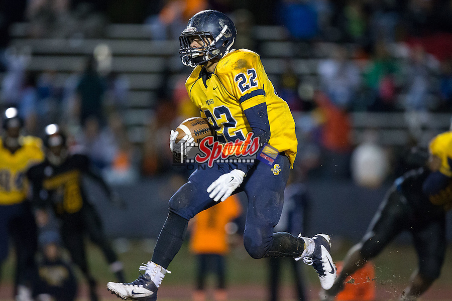 Tyree Hallman (22) of the South Iredell Vikings runs with the football during second half action against the JM Robinson Bulldogs at South Iredell High School November 20, 2015, in Statesville, North Carolina.  The Vikings defeated the Bulldogs 14-13.  (Brian Westerholt/Special to the Tribune)