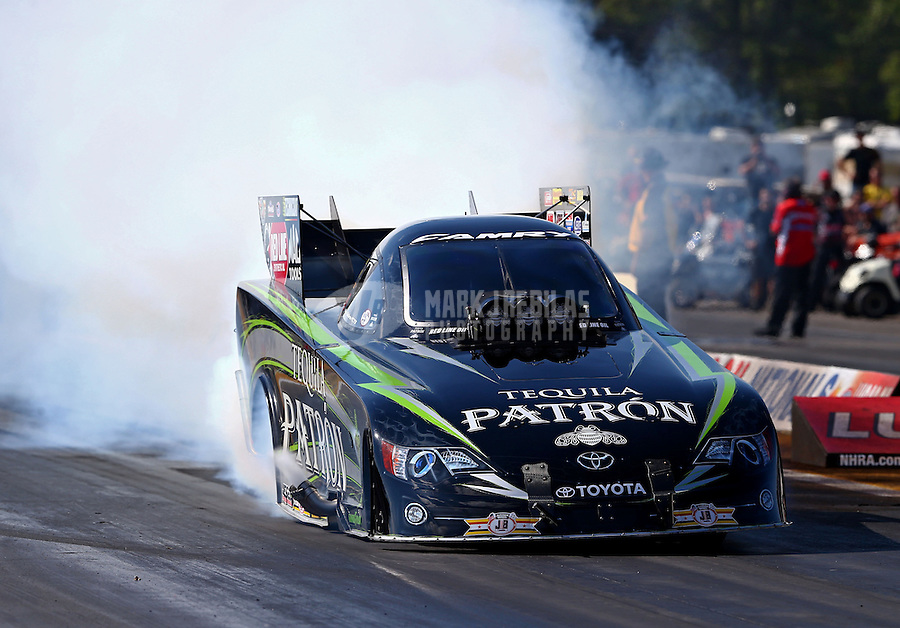 Aug. 17, 2013; Brainerd, MN, USA: NHRA funny car driver Alexis DeJoria during qualifying for the Lucas Oil Nationals at Brainerd International Raceway. Mandatory Credit: Mark J. Rebilas-