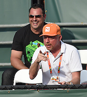 KEY BISCAYNE, FL - MARCH 27: German tennis legend and coach Boris Becker seems to still have a bad elbow as he watches Novak Djokovic of Serbia and Jarko Tipsarevic of Serbia in action against Robert Lindstedt of Sweden and Jurgen Melzer of Austria during day 5 of the Miami Open at Crandon Park Tennis Center on March 27, 2015 in Key Biscayne, Florida<br /> <br /> <br /> People:  Boris Becker<br /> <br /> Transmission Ref:  FLXX<br /> <br /> Must call if interested<br /> Michael Storms<br /> Storms Media Group Inc.<br /> 305-632-3400 - Cell<br /> 305-513-5783 - Fax<br /> MikeStorm@aol.com