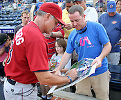 Lehigh Valley IronPigs manager and former Chicago Cubs star Ryne Sandberg signs an poster for Patrick Young, of Charlotte before the Durham Bulls vs. Lehigh Valley baseball game on Thursday, August 4, 2011. Lehigh won 5-3. Photo by Al Drago.
